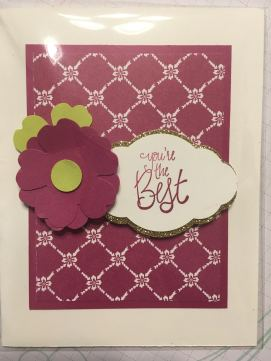 Card using Berry Burst patterned DSP, with Berry Burst flowers made with the pansy punch. Leaves are also made the Pansy punch in Lemon Lime Twist. You're the Best is stamped on white and punched with the Pretty Label. This is layered on top of Gold Glitter paper.