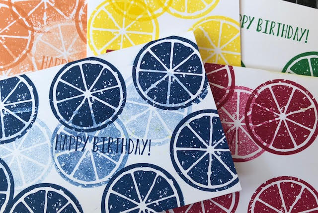 Grouping of all the notecards each stamped with the fruit slice in the same in-color on each card.